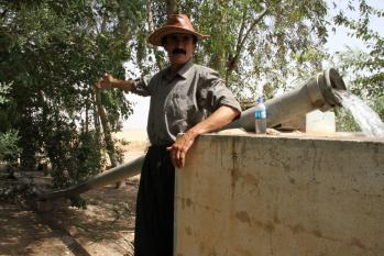 Photo credit: Emma Piper-Burket. The Kurdish farmer Kamal shows off his well and irrigation pipe on his farm west of Erbil.
