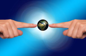 Hands pointing to Earth